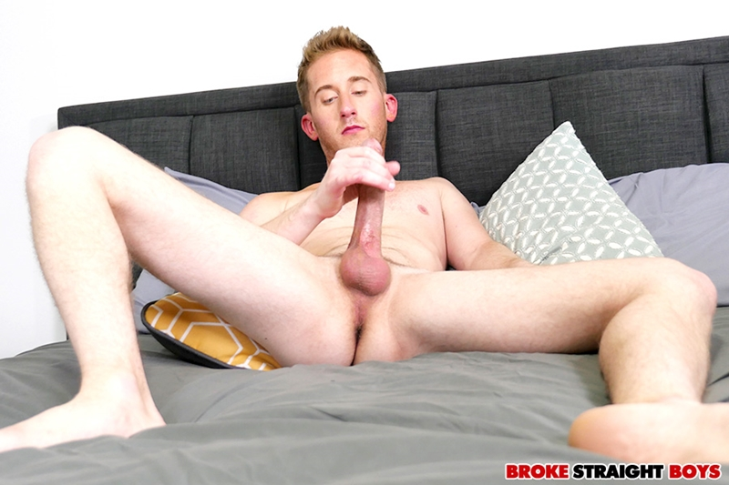 Gorgeous young red head Chase Daniels strips naked jerking his big cock till he spurts cum all over