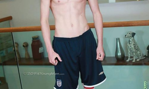 Long haired ginger soccer player Hector Turner strips out of his footie kit wanking his big uncut cock