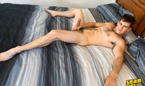 Horny hairy young muscle boy Archie Solo jerks his big dick spraying cum all over his furry abs