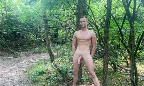 Sexy young stud Trevor Ridge's jerks his massive cock outdoors in the forest