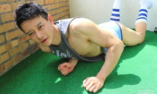 Hot young Chinese dude Anson Yang strips off his tiny shorts, muscle t-shirt and white tube sports sock jerking his cock
